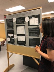 Minnie Cui giving her poster presentation